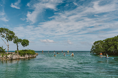 Paddling on Tobacco Caye Belize