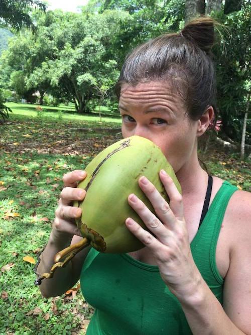 Drinking from a fresh coconut at Bocawina Rainforest Resort, Belize