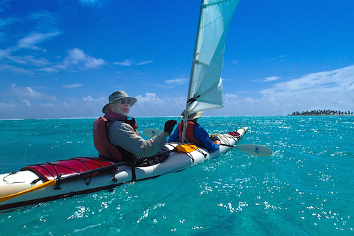 Kayak sailing on the Lighthouse Reef Atoll, Belize